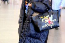 14 Rihanna rocking a bright sporty look with a blanket padded coat and a bright bag