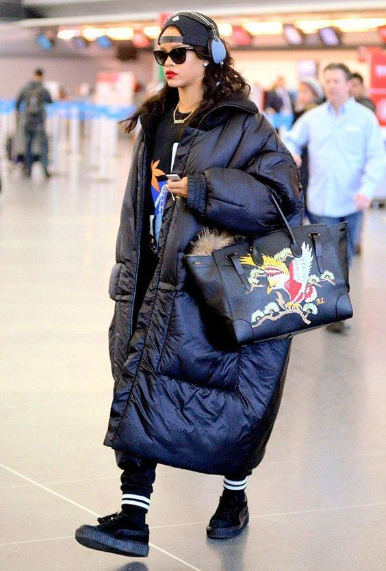 Rihanna rocking a bright sporty look with a blanket padded coat and a bright bag