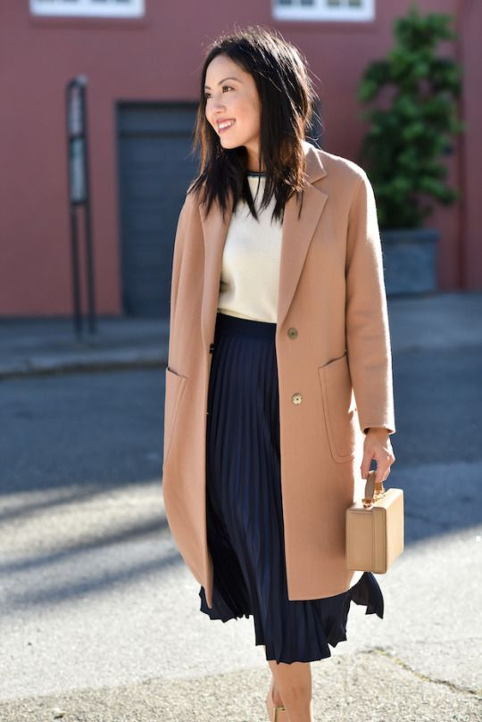 a casual work look with a navy pelated midi, a white top, a blush straight coat and a stylish bag
