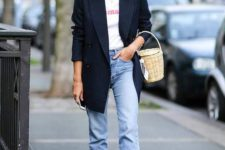14 a printed tee, blue jeans with a raw hem, red boots, a navy thin stripe blazer and a basket bag