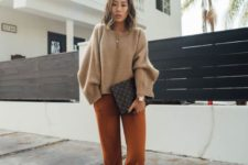 14 a simple outfit with a tan cropped sweater, rust-colored pants, mustard shoes and a black printed bag