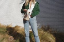 14 a white shirt, blue jeans with a raw hem, black combat boots, a green jacket and a small bag for a 90s chic look