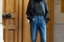 14 blue cropped jeans, a black turtleneck, a black leather shirt on top and nude heels