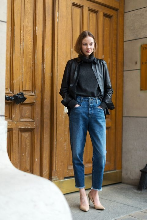 blue cropped jeans, a black turtleneck, a black leather shirt on top and nude heels