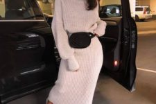 15 a simple look with a white chunky knit suit with a turtleeck sweater and a maxi skirt, white trainers and a black belt bag
