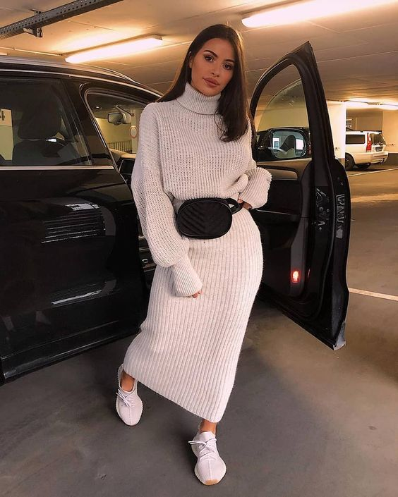 a simple look with a white chunky knit suit with a turtleeck sweater and a maxi skirt, white trainers and a black belt bag