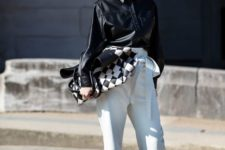 15 a statement minimalist look with white high waisted pants, a black leather shirt, white shoes and a checked bag