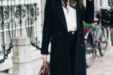 15 a stylish look with a black straight coat, a black hat and white sneakers looks modern and fresh