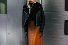 15 a stylish look with a black turtleneck, an amber leather midi skirt, matching boots and a black aviator coat