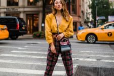15 a yellow shirt, plaid pants, metallic gold booties and a two tone mini bag for a bold and sexy look