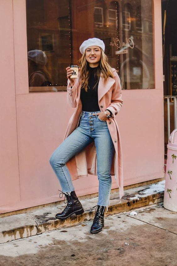 blue cropped jeans with a raw hem, black combat boots, a black turtleneck, a pink trench and a beret
