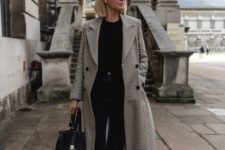 16 a casual look with black jeans, a black top, white trainers, a black backpack and a printed straight midi coat
