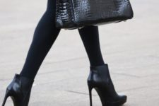 16 a classic black bag of crocodile leather is a timeless solution, great for going to work