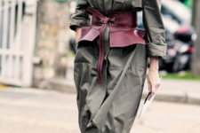16 an olive green midi shirtdress with long sleeves, a burgundy corset belt and white shoes