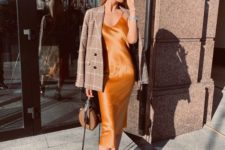 16 an orange slip midi dress, black boots, a plaid blazer and a brown bag for a refined fall outfit