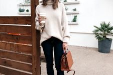 16 an oversized white sweater, navy cuffed skinnies, leopard print flats and a camel bag for a casual look