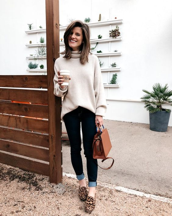 an oversized white sweater, navy cuffed skinnies, leopard print flats and a camel bag for a casual look