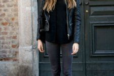 16 grey jeans, black combat boots, a black long sleeve top and a black leather jacket for a monochromatic look
