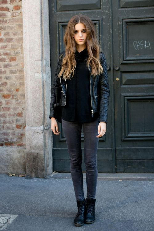 grey jeans, black combat boots, a black long sleeve top and a black leather jacket for a monochromatic look
