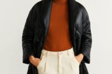 17 a minimalist look with creamy pants, a rust-colored turtleneck, a black leather midi padded coat