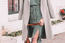 18 a girlish outfit with a striped midi dress with a slit, white booties, a grey straight coat and a brown bag