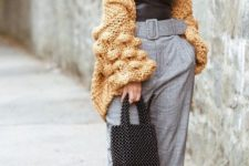 18 a sexy outfit with a black leather top, grey plaid pants, a yellow cunky knit cardigan and heels