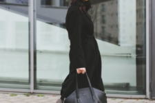19 a black coat, white sneakers and a black cap make up a bold yet casual enough outfit for the winter