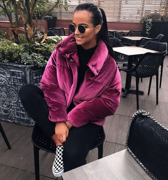 a chic outfit with a black top and skinnies, checked slipons and a fuchsia velvet padded jacket