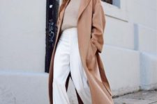 19 a minimalist look with a neutral cashmere top, white wideleg pants, white boots and a camel straight coat