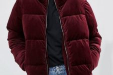 20 a 90s inspired look with blue straight jeansm a black tee, a burgundy velvet padded jacket