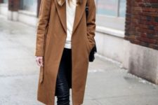 20 a casual winter look with a white top, black leather leggings, black sneakers, a camel straight coat, a black bag and a black beanie