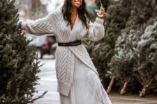20 a white pleated maxi skirt, a neutral chunky knit cardigan with a brown belt and brown boots