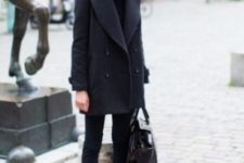 22 a total black look with a sweater, skinnies, booties, a bag for winter is very warm and cozy