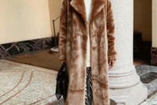 22 a trendy look with a camel faux fur coat, white boots and a black bucket hat for winter