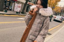 23 a padded midi coat that imitates plaid tweed and is decorated with neutral faux fur