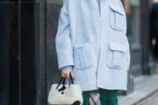 23 a stylish fall look with a powder blue coat, a black bucket hat, black sock boots and a fur bag