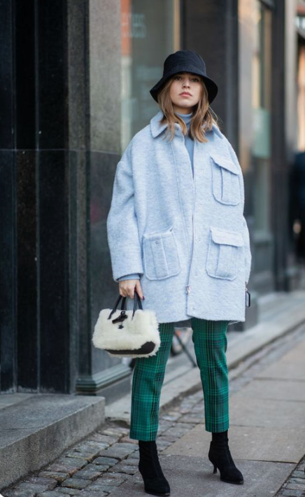 a stylish fall look with a powder blue coat, a black bucket hat, black sock boots and a fur bag