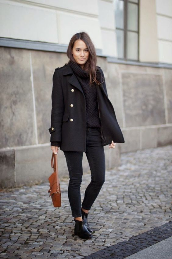 a comfortable and chic total black look with a sweater, a pea coat, skinnies, booties and a brown bag