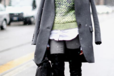 24 a grey coat paired with a faux fur hat looks very nice and very cool for the winter