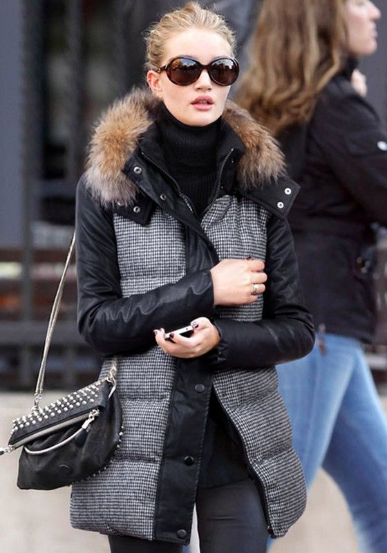 a padded jacket that imitates wool and features black sleeves and faux fur