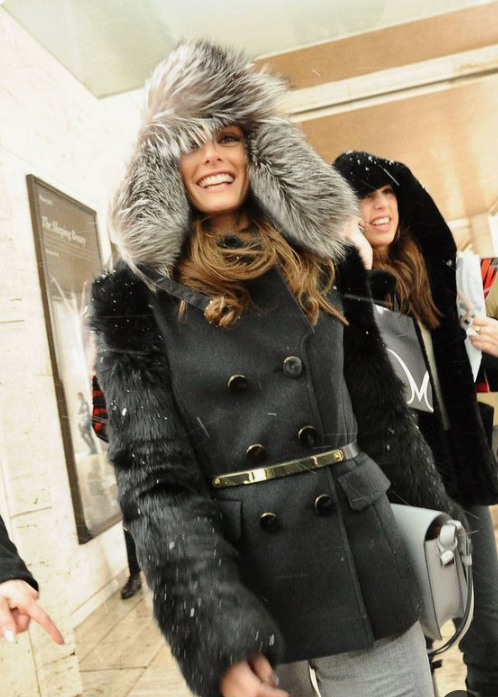 a belted coat with a faux fur hat for a bold and trendy winter outfit