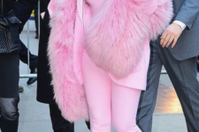 Rihanna wearing a hot pink faux fur coat to match her suit looks just wow