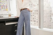 With beige loose blouse, brown belt and shoes