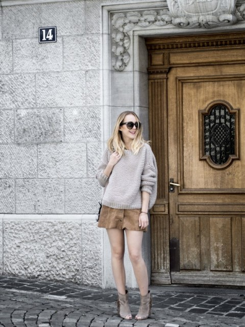 With beige oversized sweater, suede cutout boots and bag
