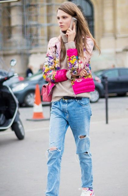 With beige turtleneck sweater, distressed jeans, pink bag and sneakers