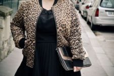 With black airy dress and clutch
