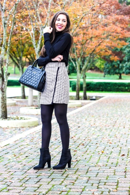 With black bag, shirt and heeled boots