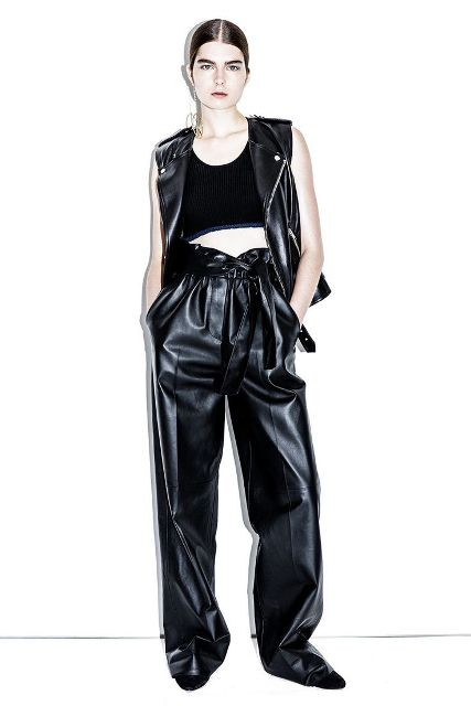 With black crop top, black leather vest and flat shoes