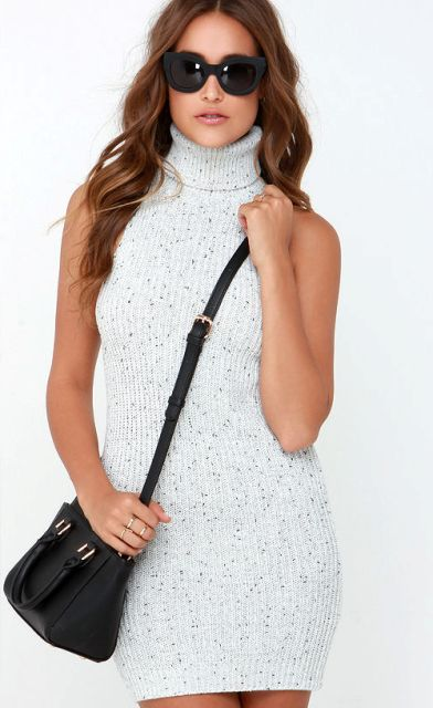 With black crossbody bag and sunglasses