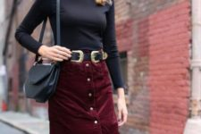 With black fitted shirt and black leather bag